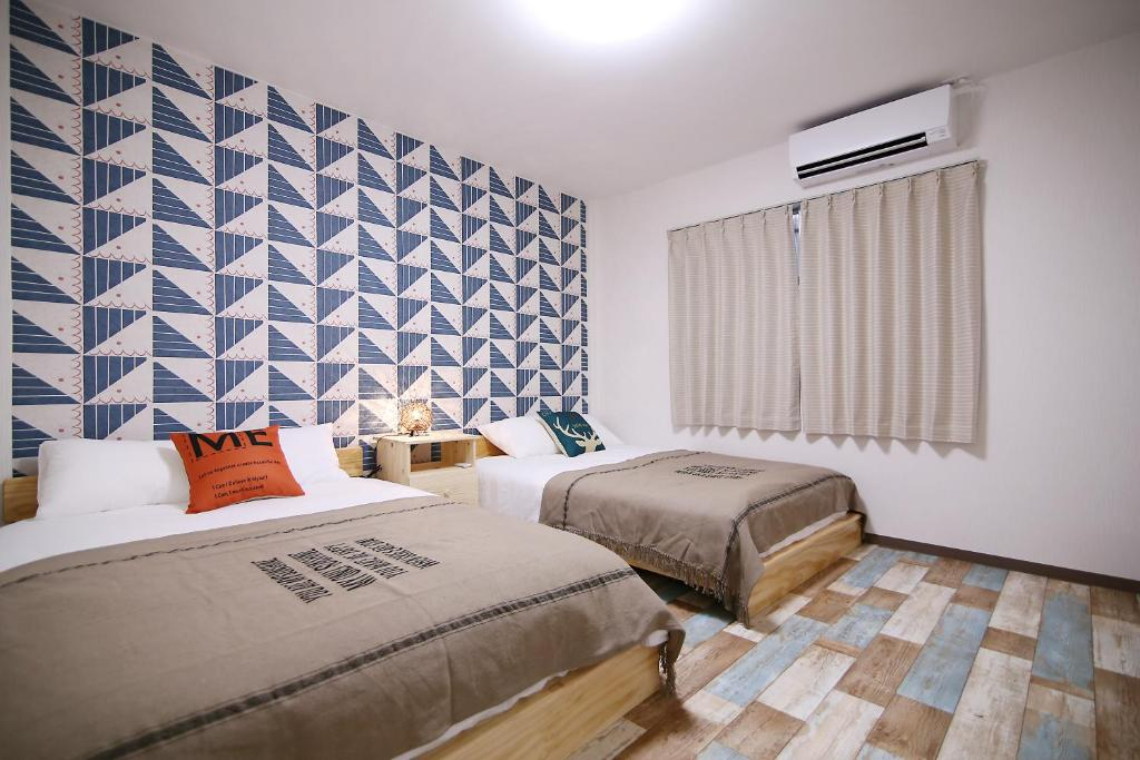 A bed or beds in a room at KINO ASAKUSA HOUSE