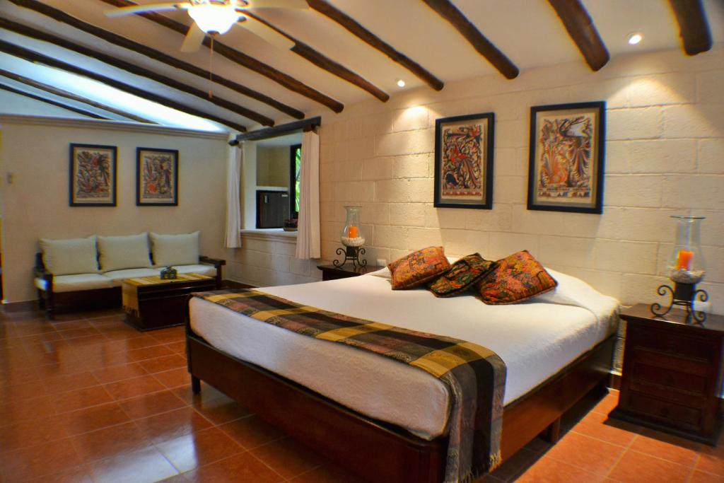 A bed or beds in a room at Hacienda Chichen Resort and Yaxkin Spa