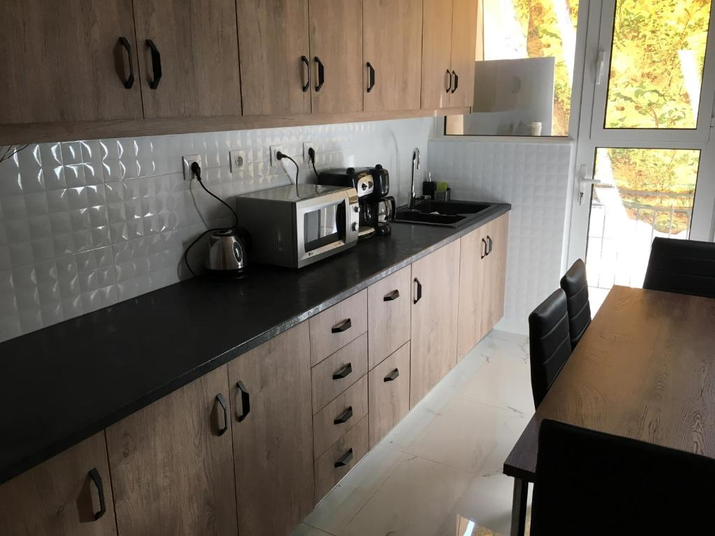 A kitchen or kitchenette at Renovated apartment, 1' to metro st. Panormou