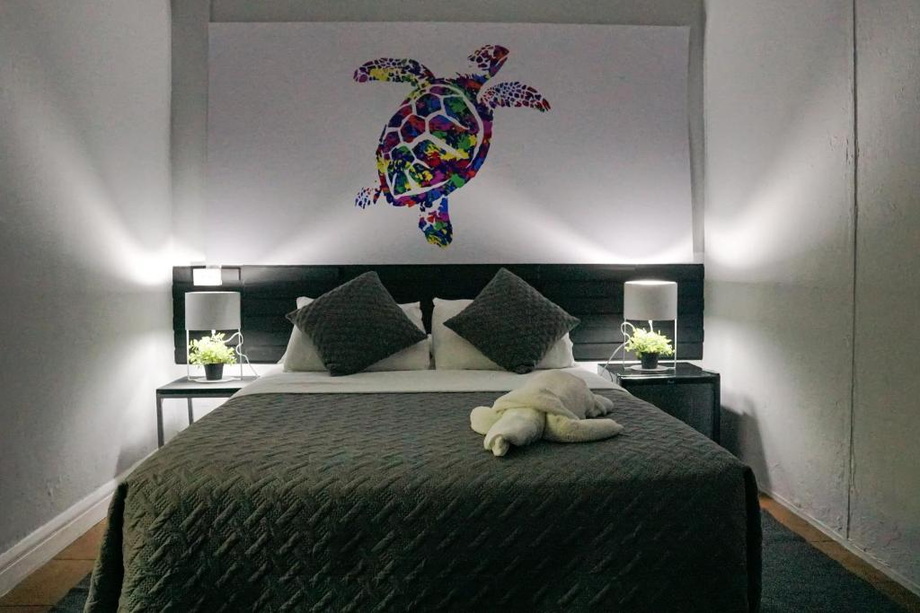 A bed or beds in a room at Turtle Saving Hostel