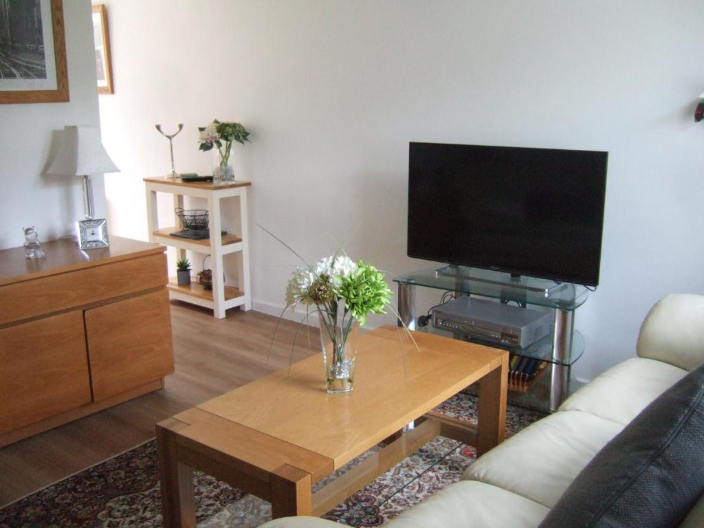 A television and/or entertainment center at Gibbs Couch