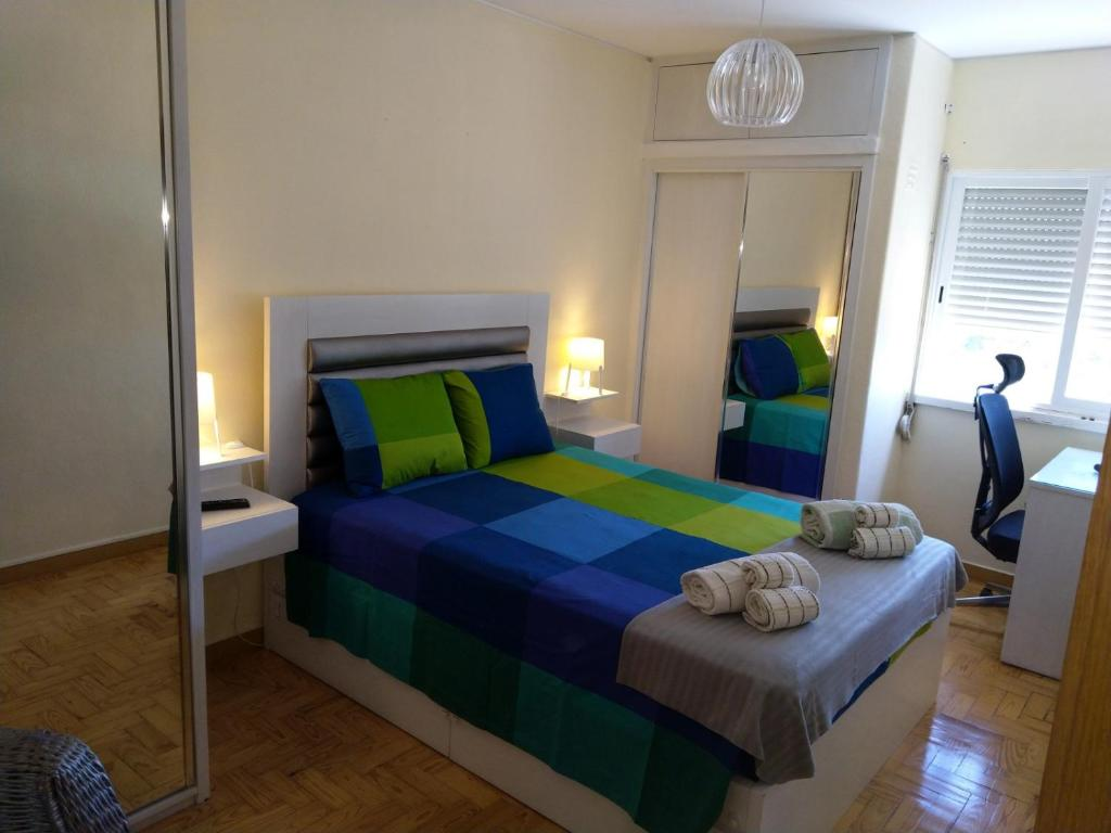 A bed or beds in a room at NEASA Lisbon Airport/EXPO