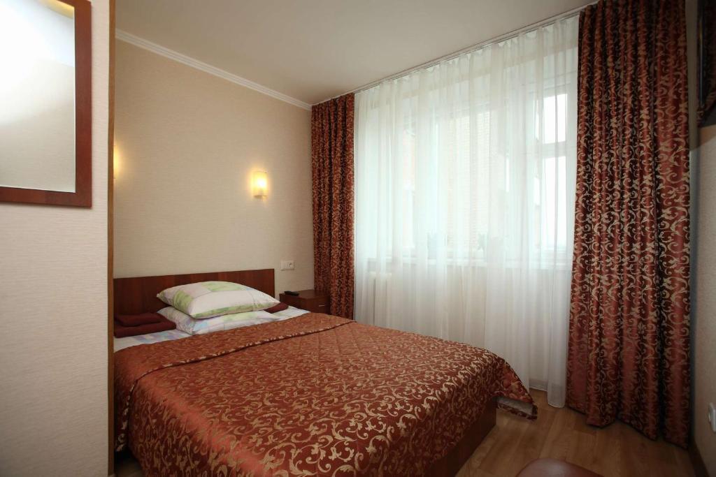 Кровать или кровати в номере Гостиница Островок