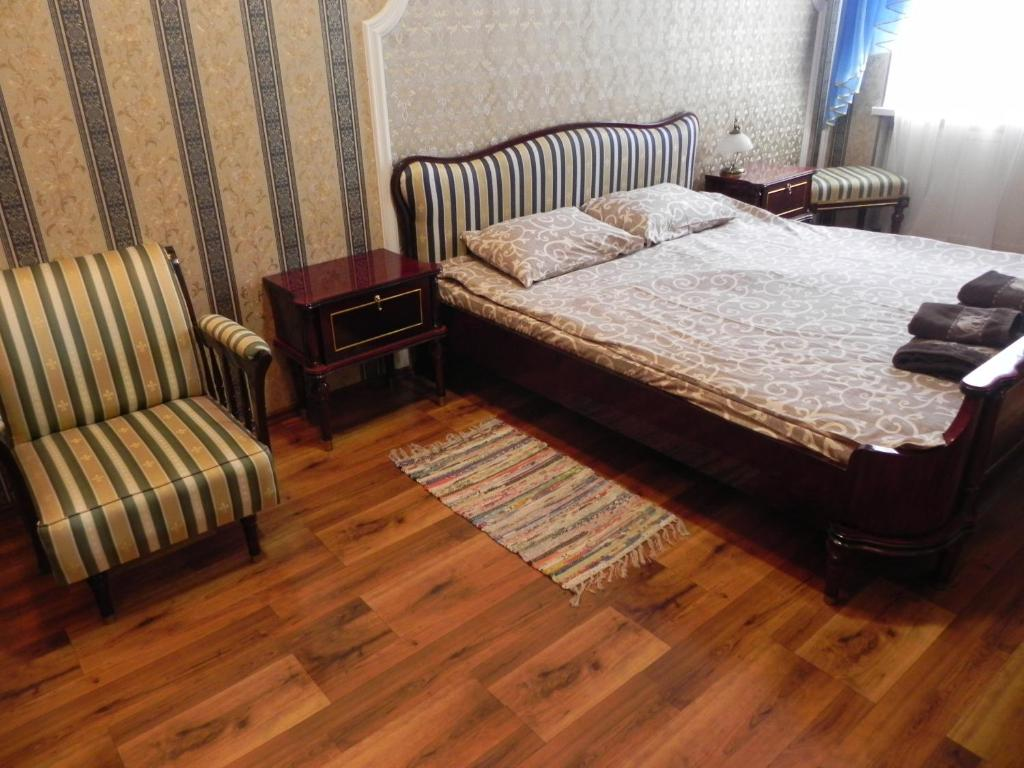 A bed or beds in a room at The Heart of Lviv Apartments - Lviv