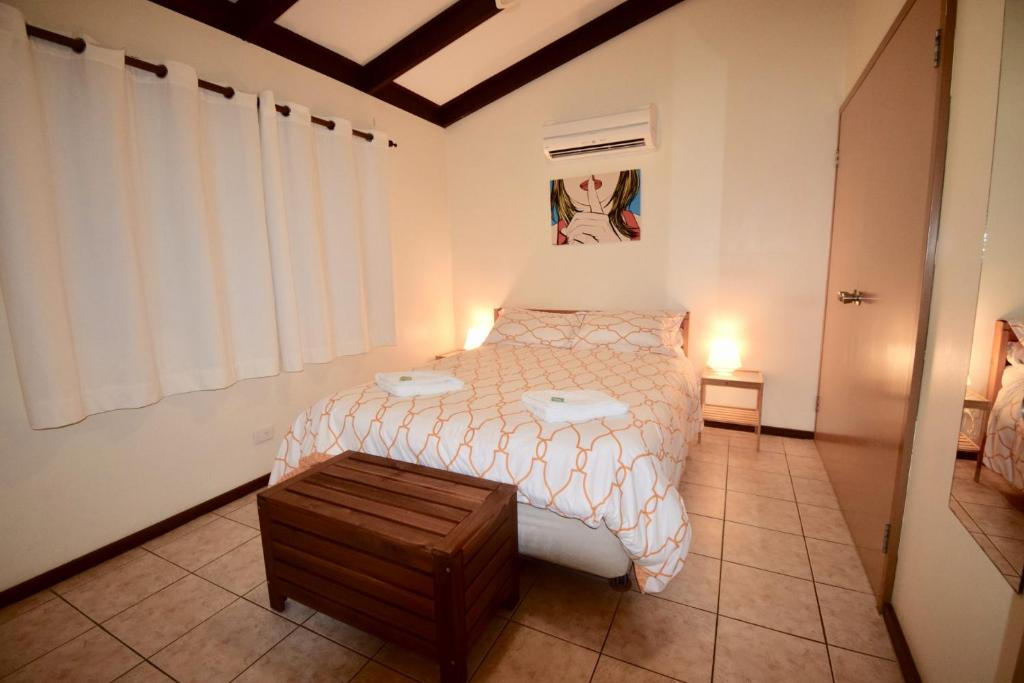 A bed or beds in a room at Wildsights Villas