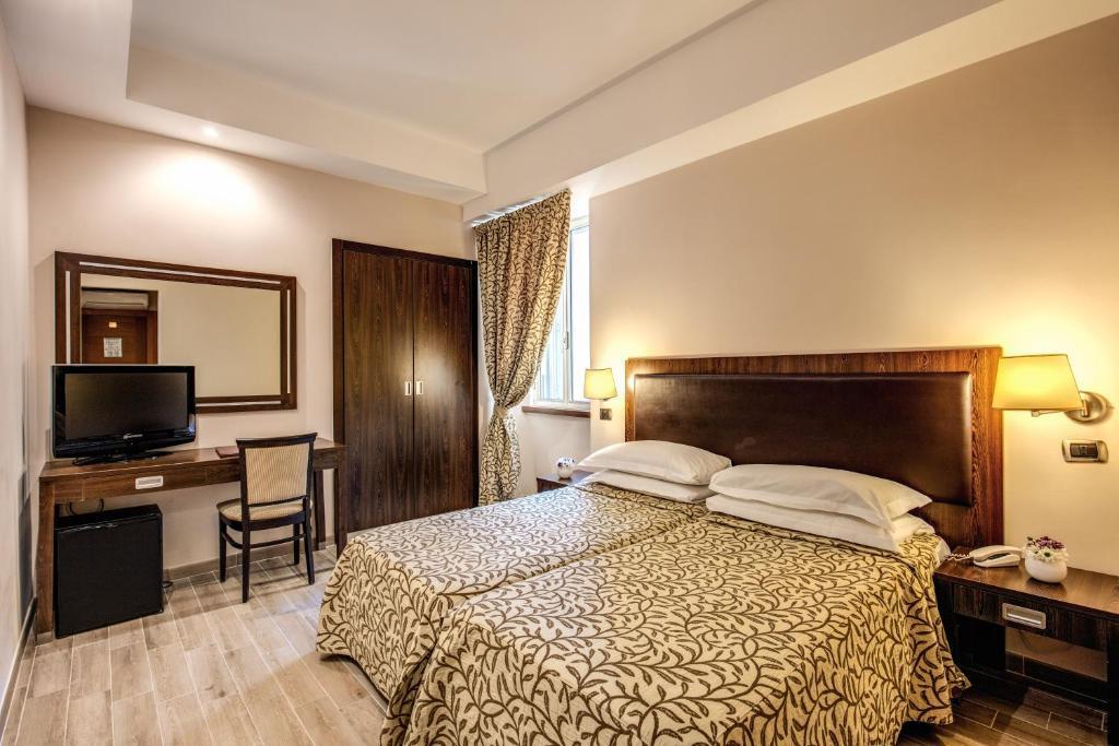Un ou plusieurs lits dans un hébergement de l'établissement Hotel Villafranca