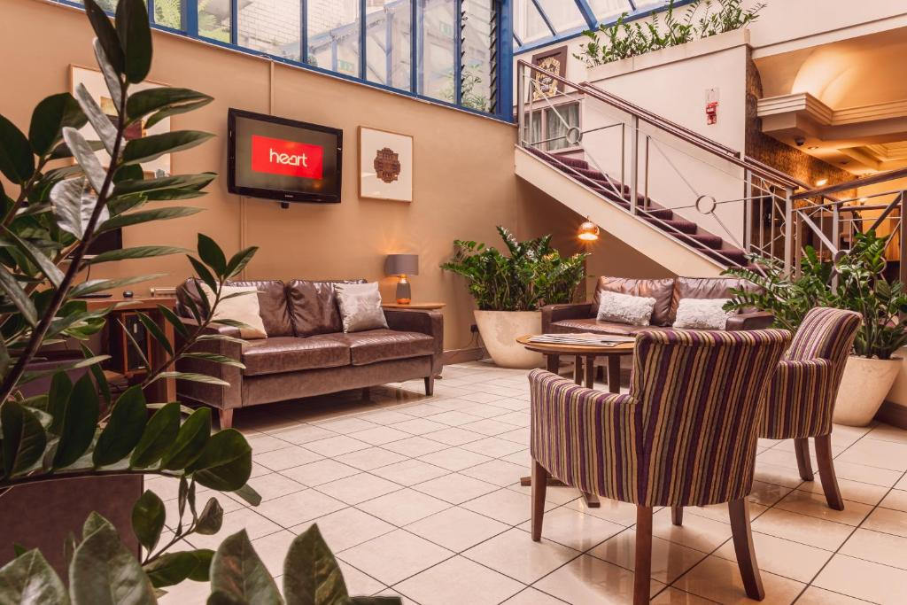 A seating area at The Gardens Hotel