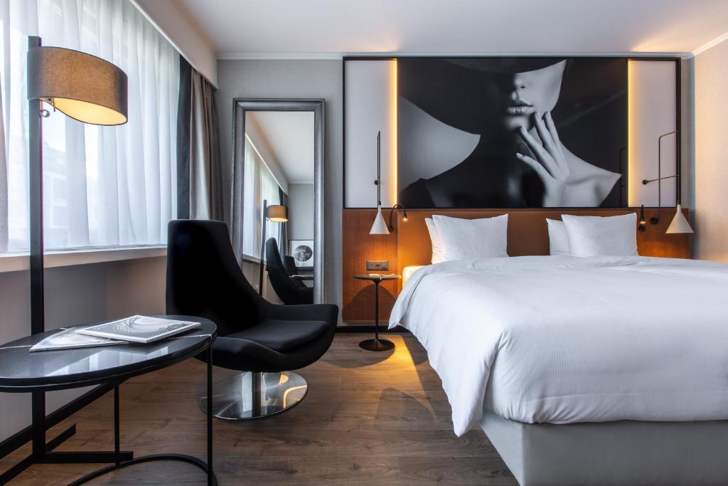 Cama o camas de una habitación en Radisson Blu, Basel