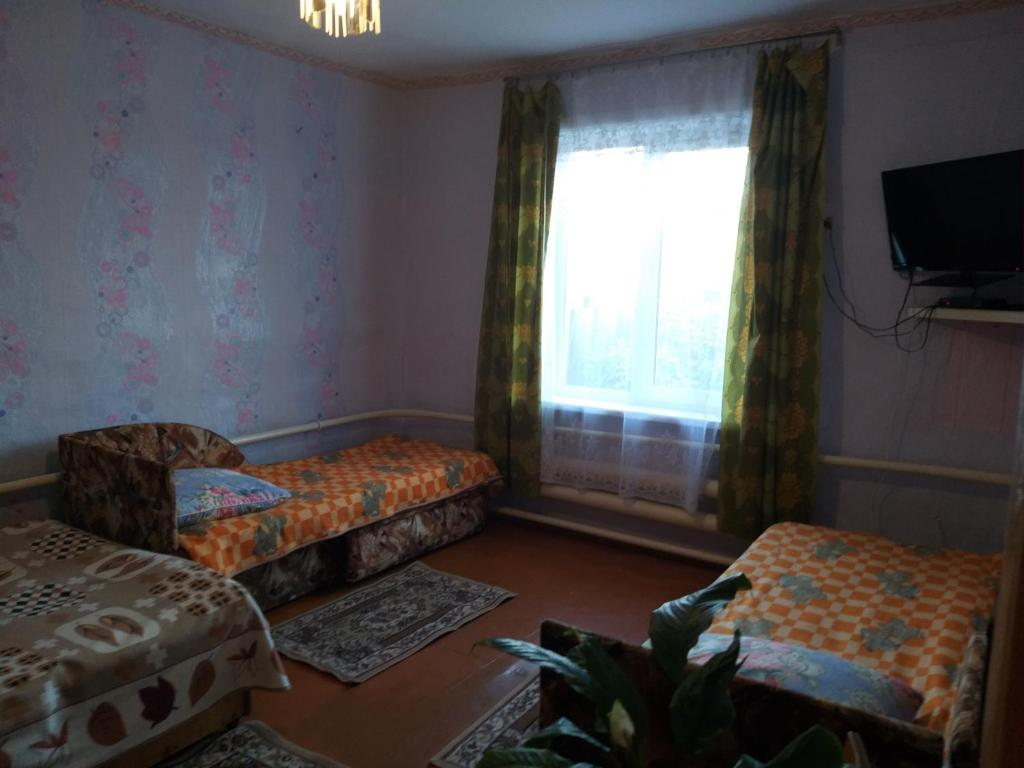 A bed or beds in a room at Guest House Naran