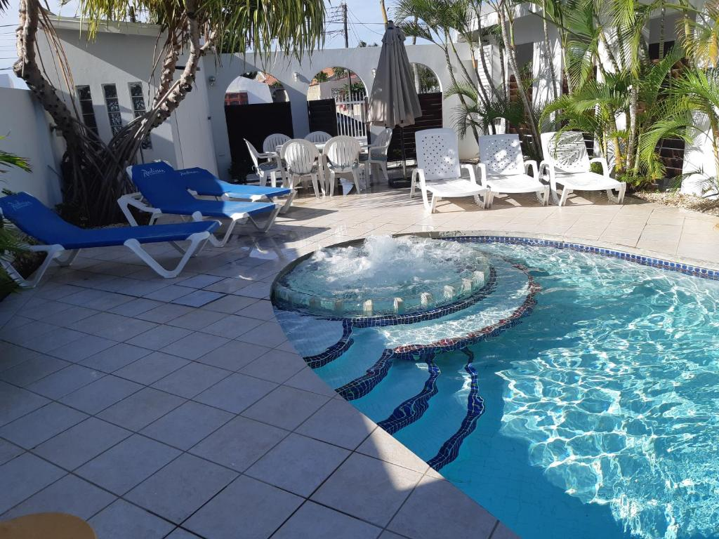 The swimming pool at or near Palm Beach Vacation Villa