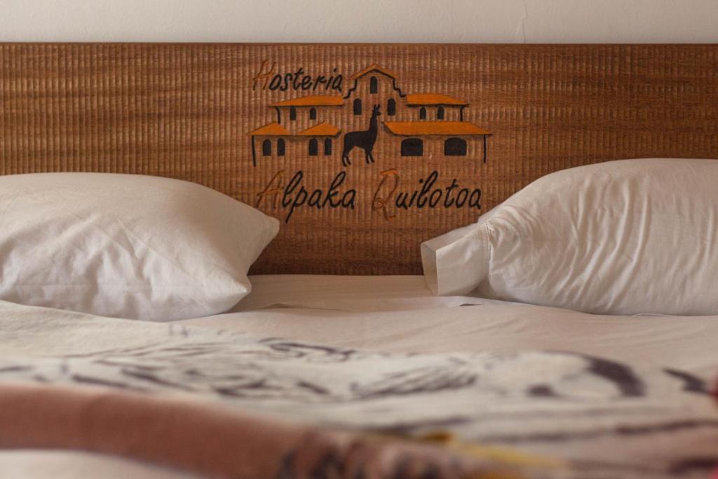 Un ou plusieurs lits dans un hébergement de l'établissement Hosteria Alpaka Quilotoa