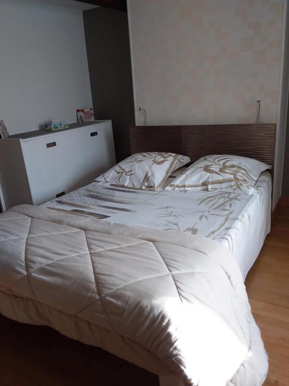 Un ou plusieurs lits dans un hébergement de l'établissement Chez Christian
