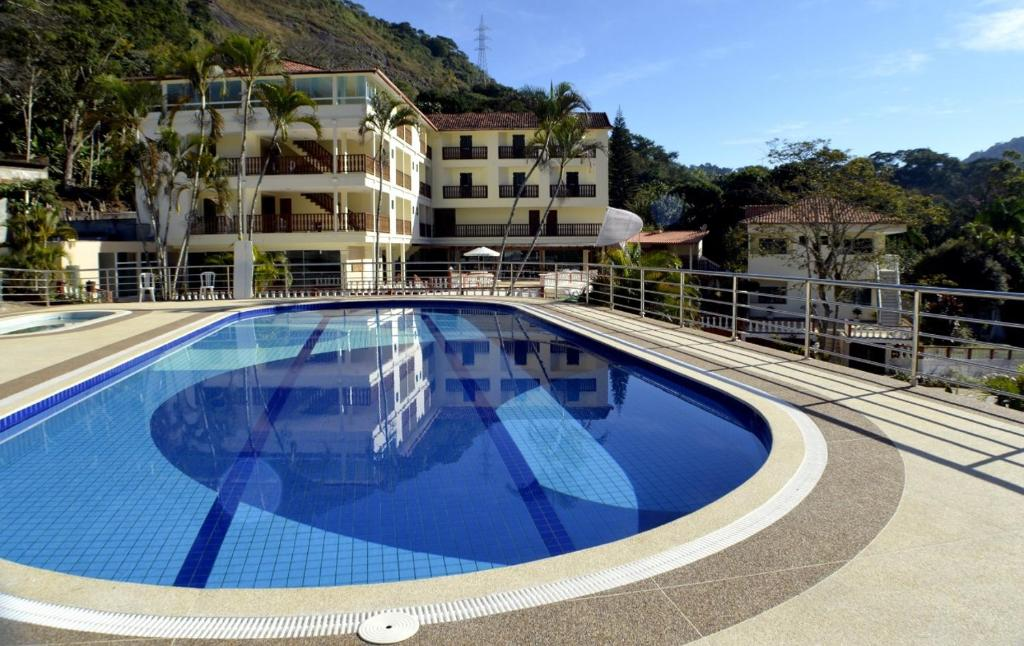The swimming pool at or near Novo Hotel Terra Do Sol