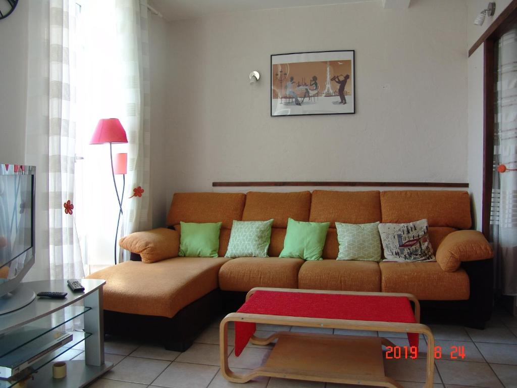Coin salon dans l'établissement Apartment Natik
