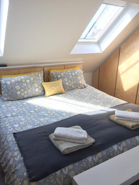A bed or beds in a room at Brand New Converted Cottage