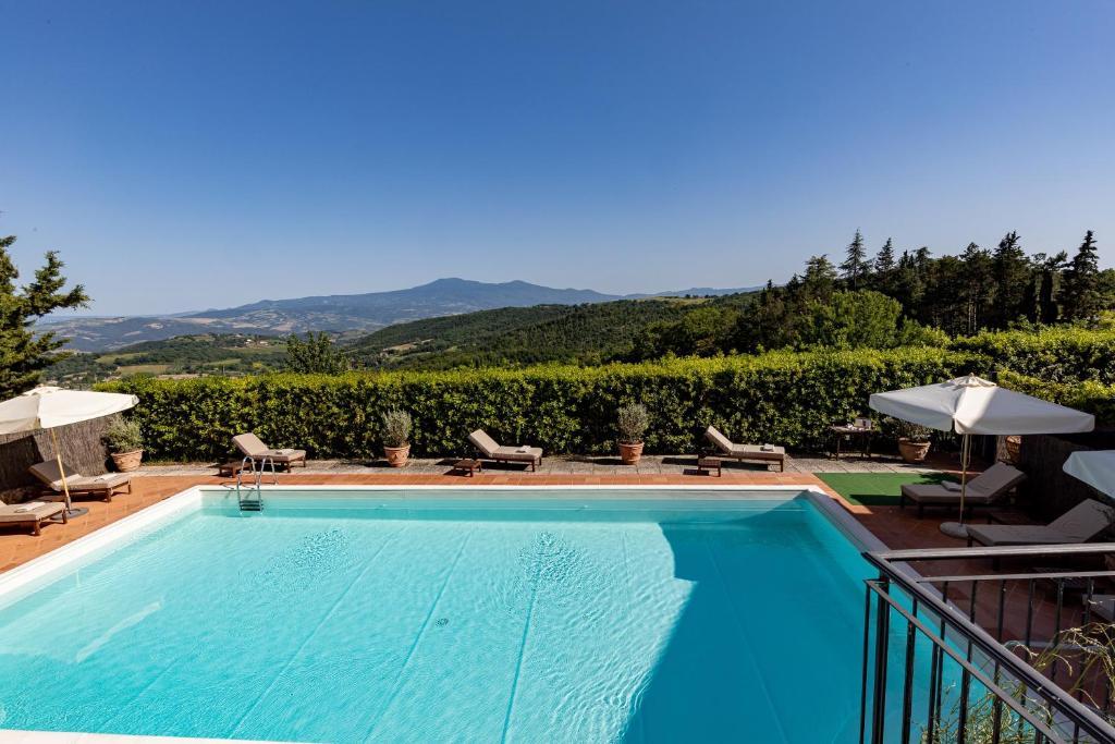Бассейн в Si Montalcino Hotel & Restaurant или поблизости