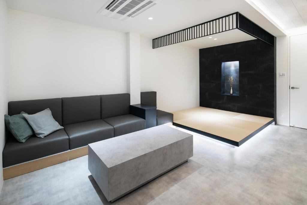 A seating area at SITSURAE OSAKA Shinsaibashi