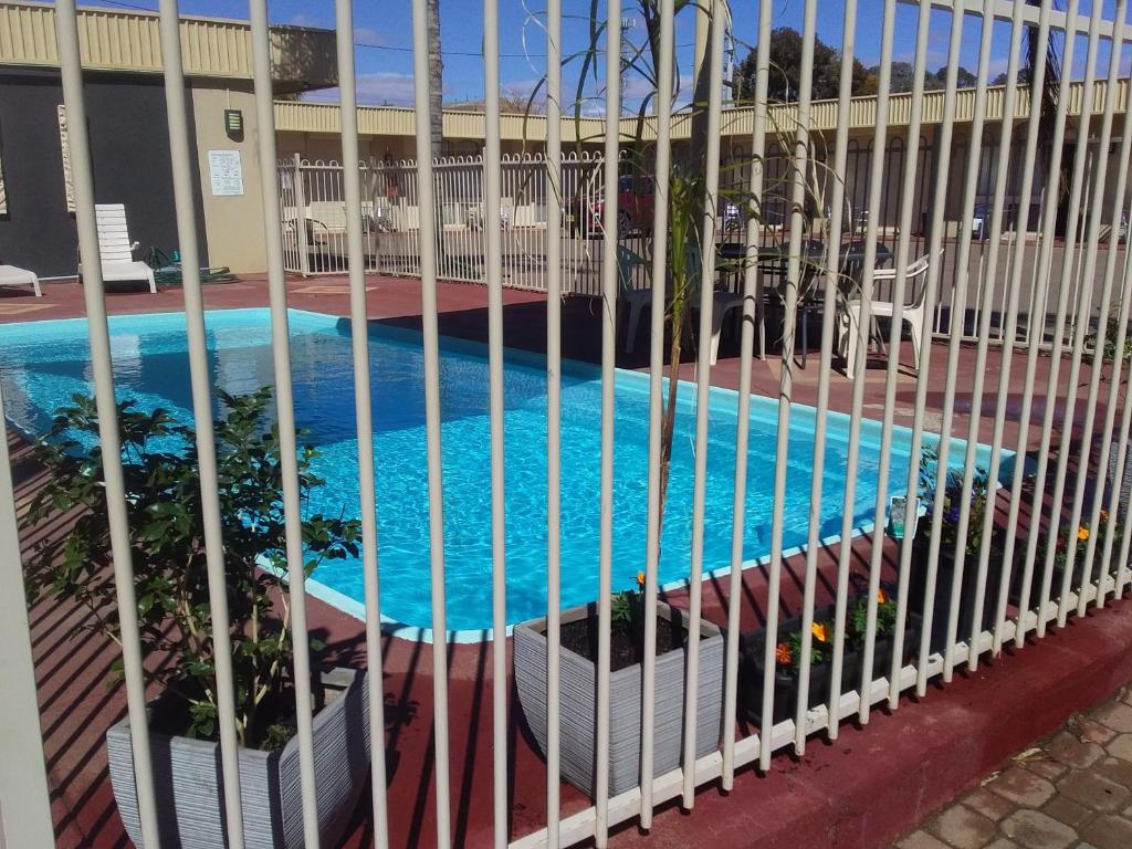 A view of the pool at Desert Sand Motor Inn or nearby