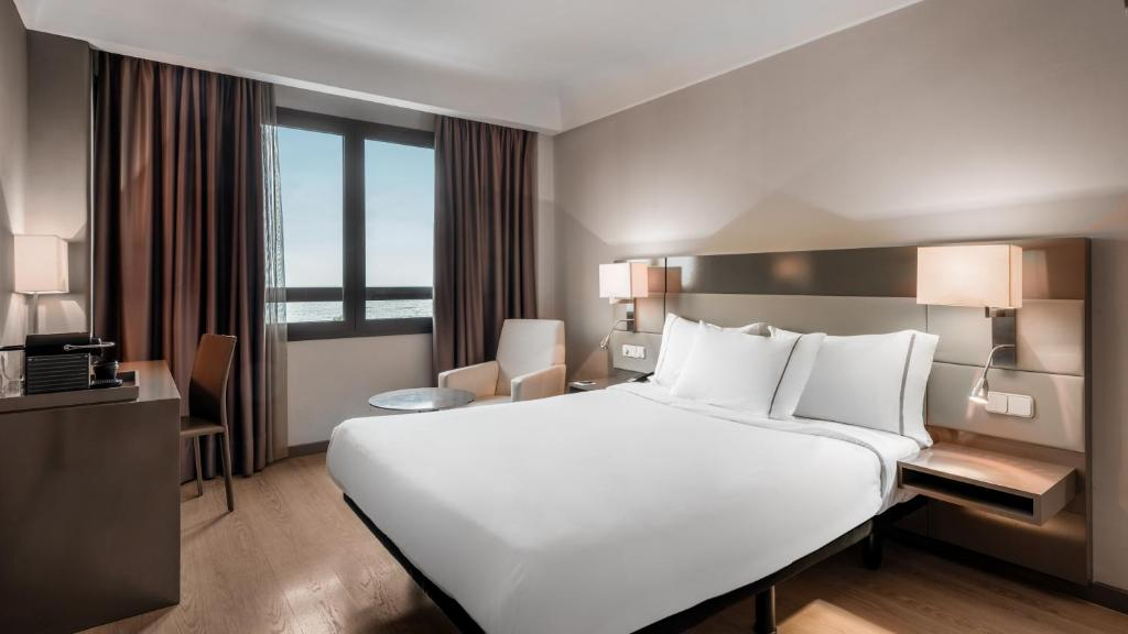 A bed or beds in a room at AC Hotel Iberia Las Palmas