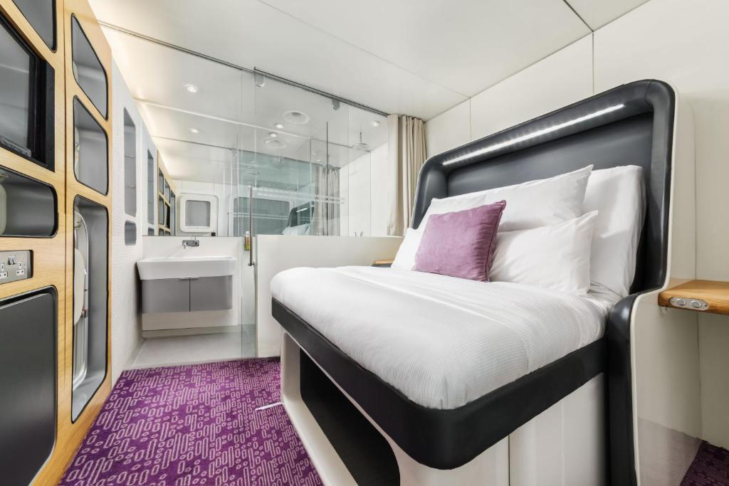 A bed or beds in a room at YOTELAIR Amsterdam Schiphol Transit Hotel