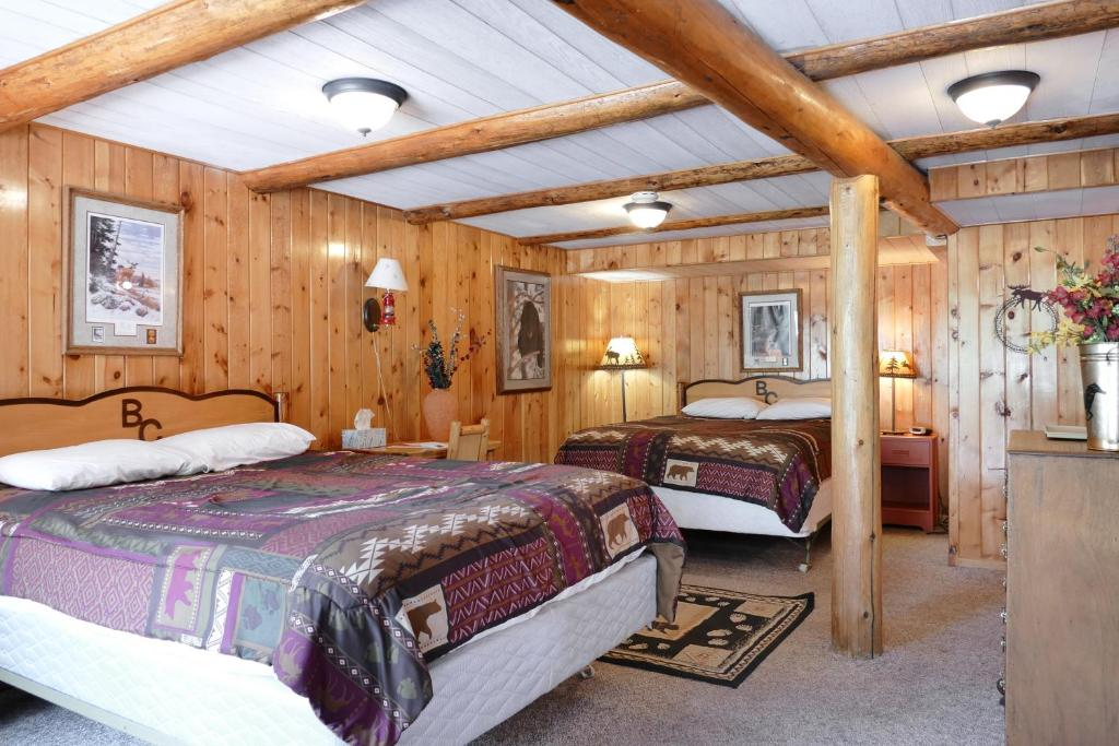 A bed or beds in a room at Bill Cody Ranch