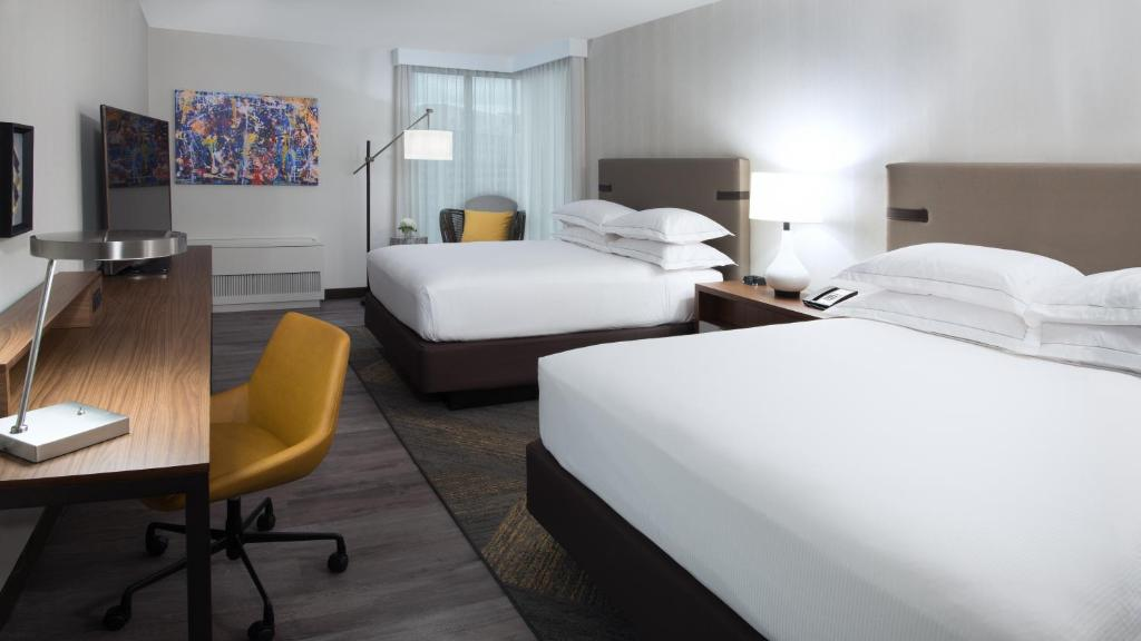 A bed or beds in a room at The Bethesdan Hotel, Tapestry Collection by Hilton