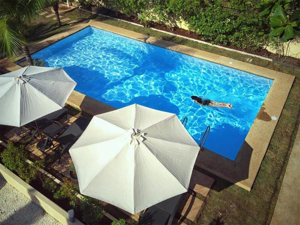 A view of the pool at Alona42 Resort or nearby