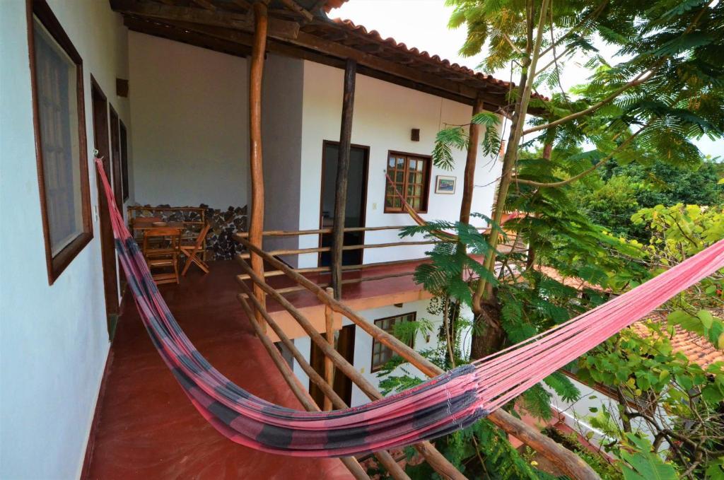 A balcony or terrace at Doce Lar Hospedaria