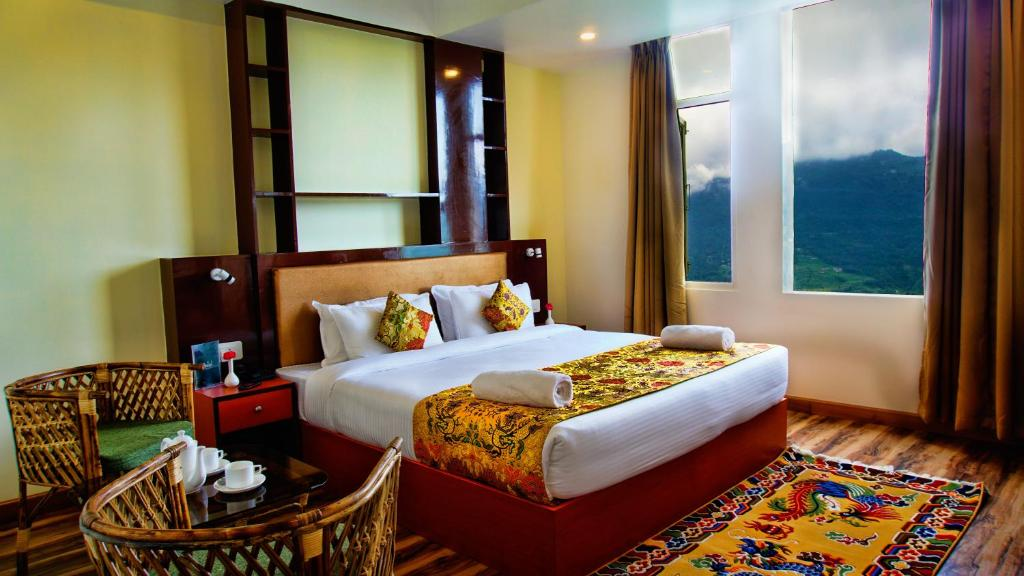 A bed or beds in a room at Muscatel Bellevue