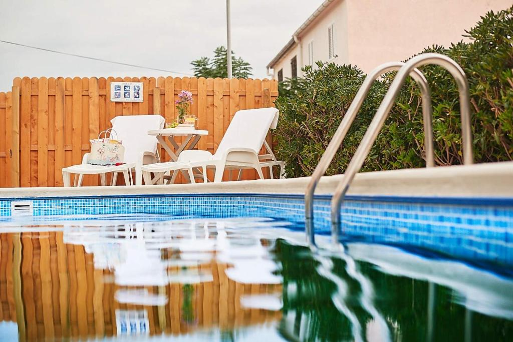 The swimming pool at or near Apartments Adriapag