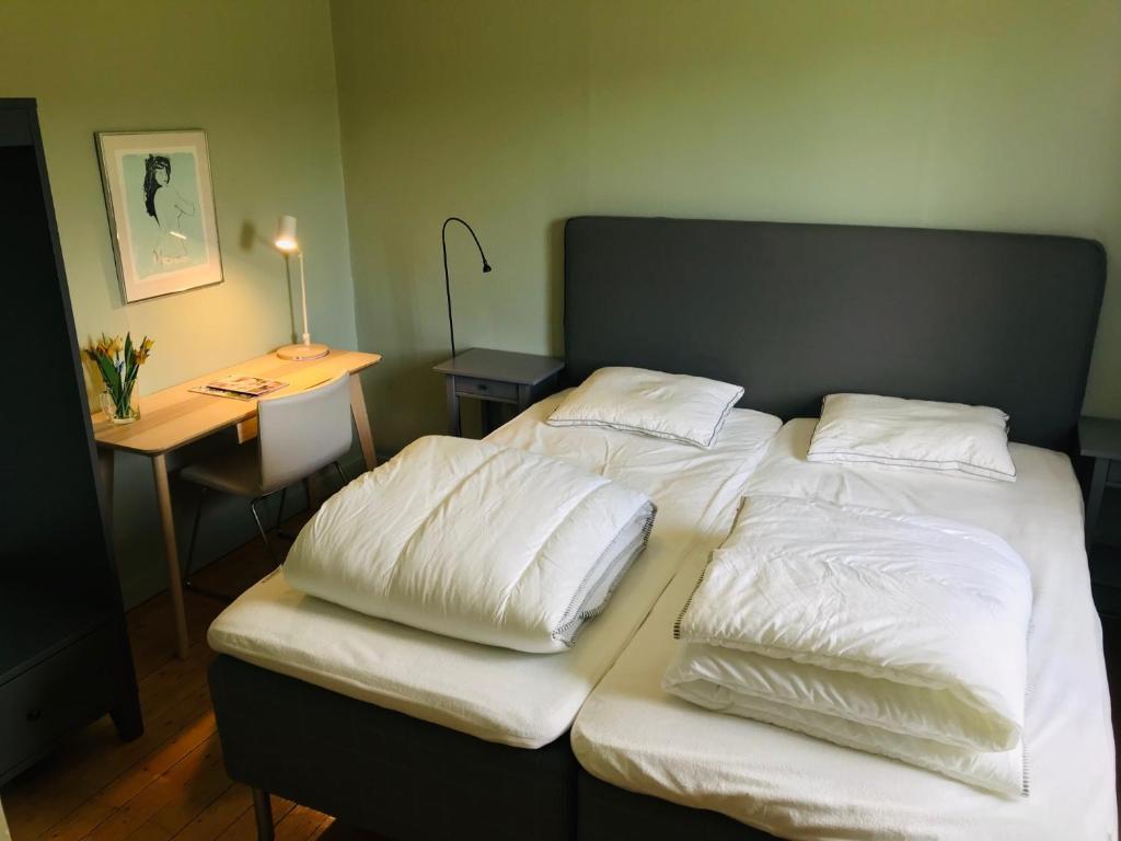 Vuode tai vuoteita majoituspaikassa Tjällets Fjällgård