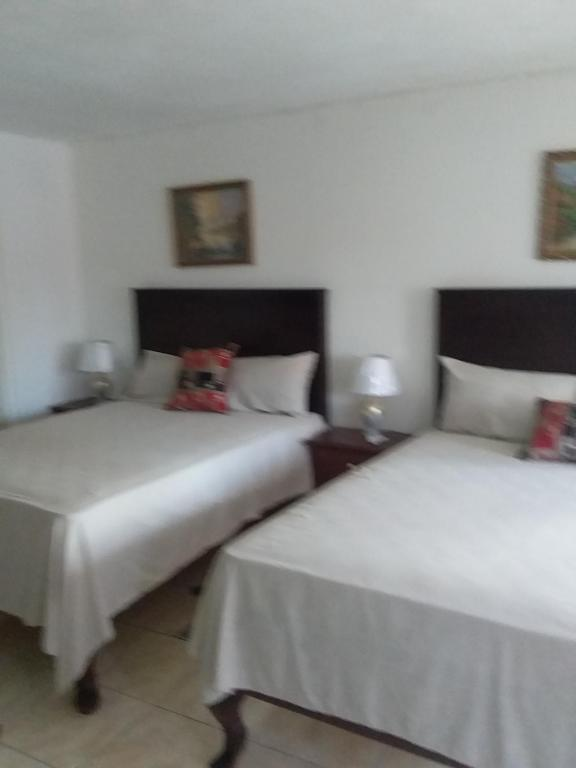 A bed or beds in a room at Trupsi Home