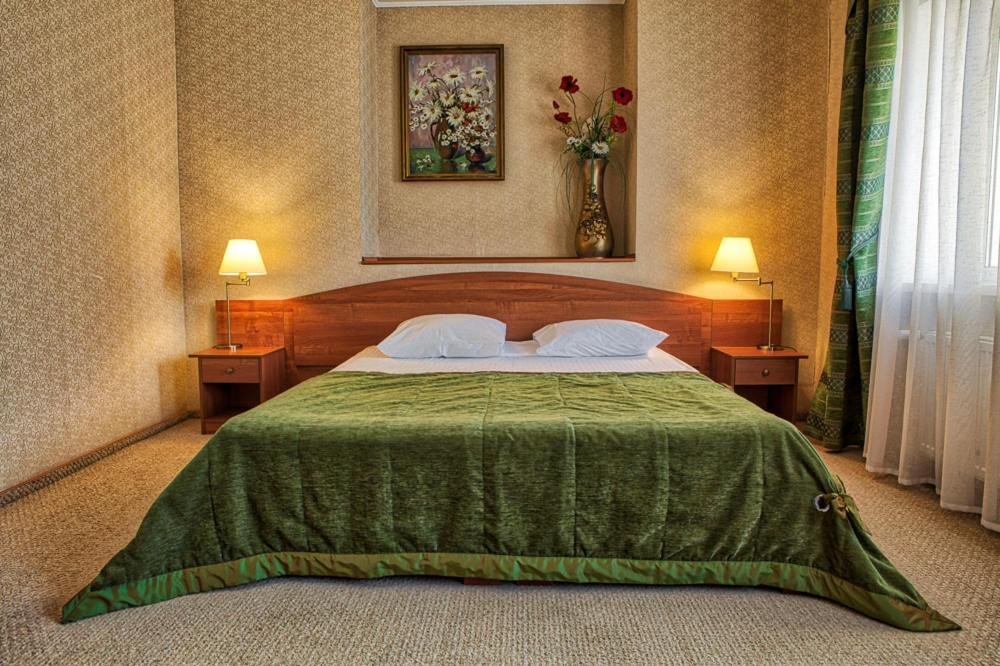 A bed or beds in a room at Premier Compass Hotel Kherson
