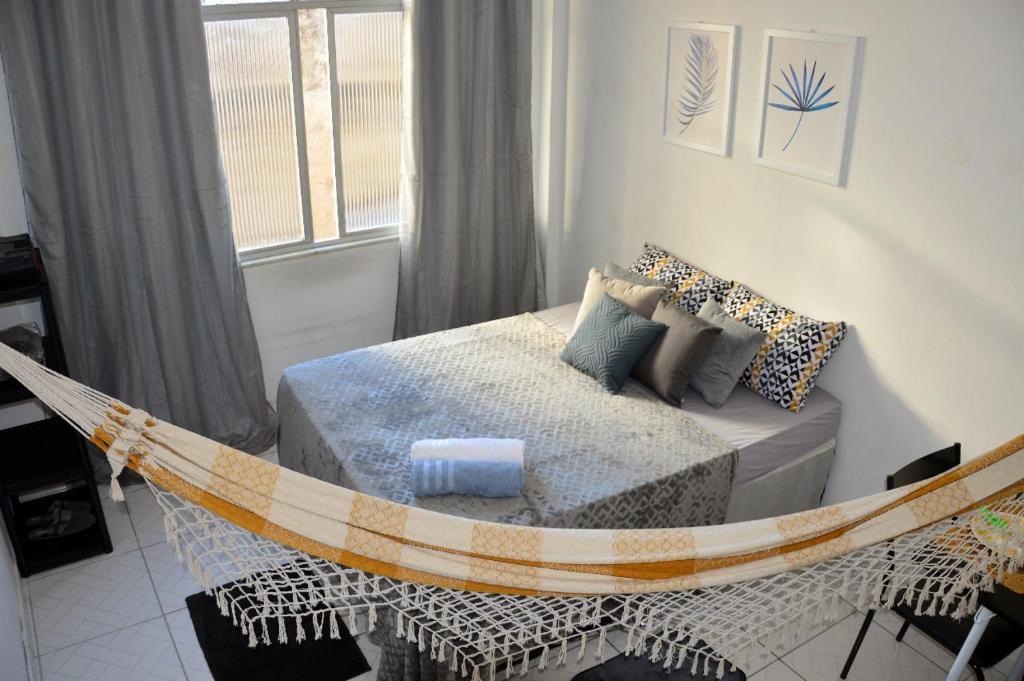 A bed or beds in a room at Acomodação em Salvador
