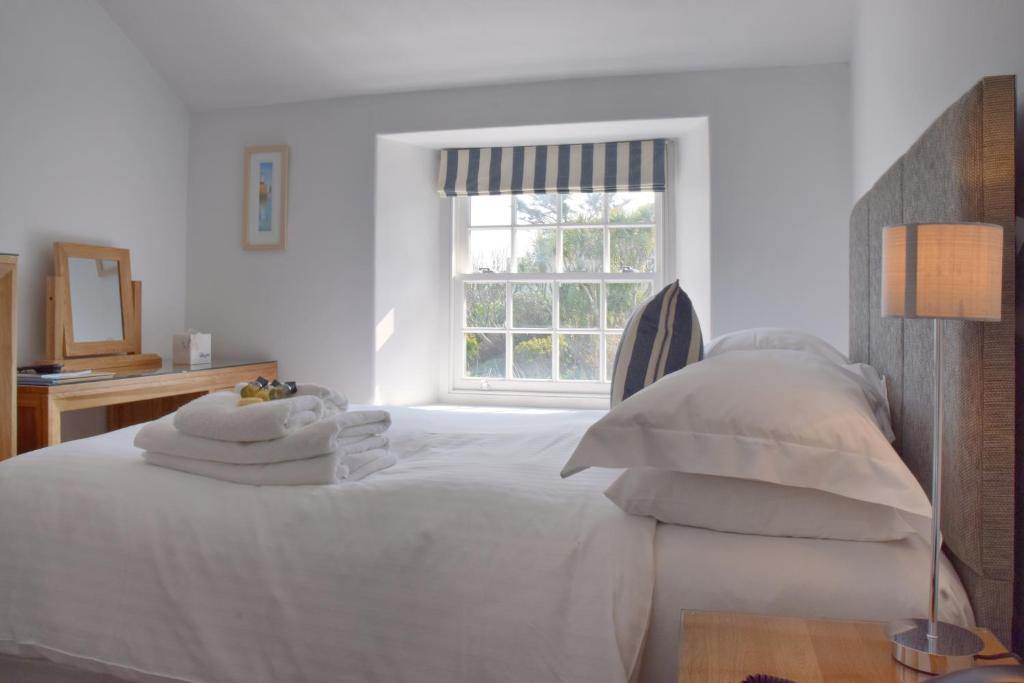 A bed or beds in a room at The Garrack Hotel & Restaurant