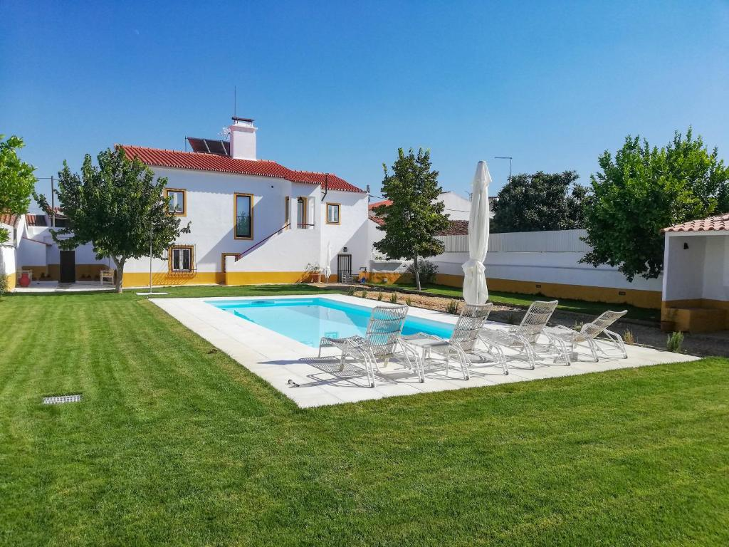 The swimming pool at or near Casa Brazao de Mira