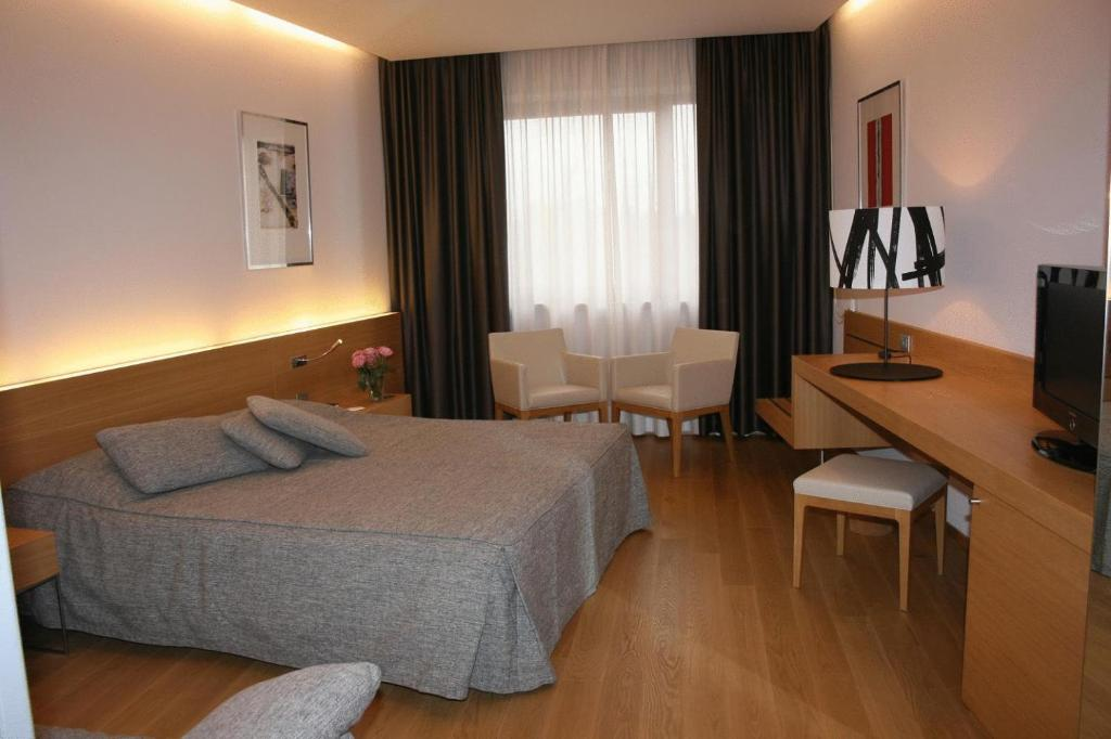 Letto o letti in una camera di Hotel Internazionale