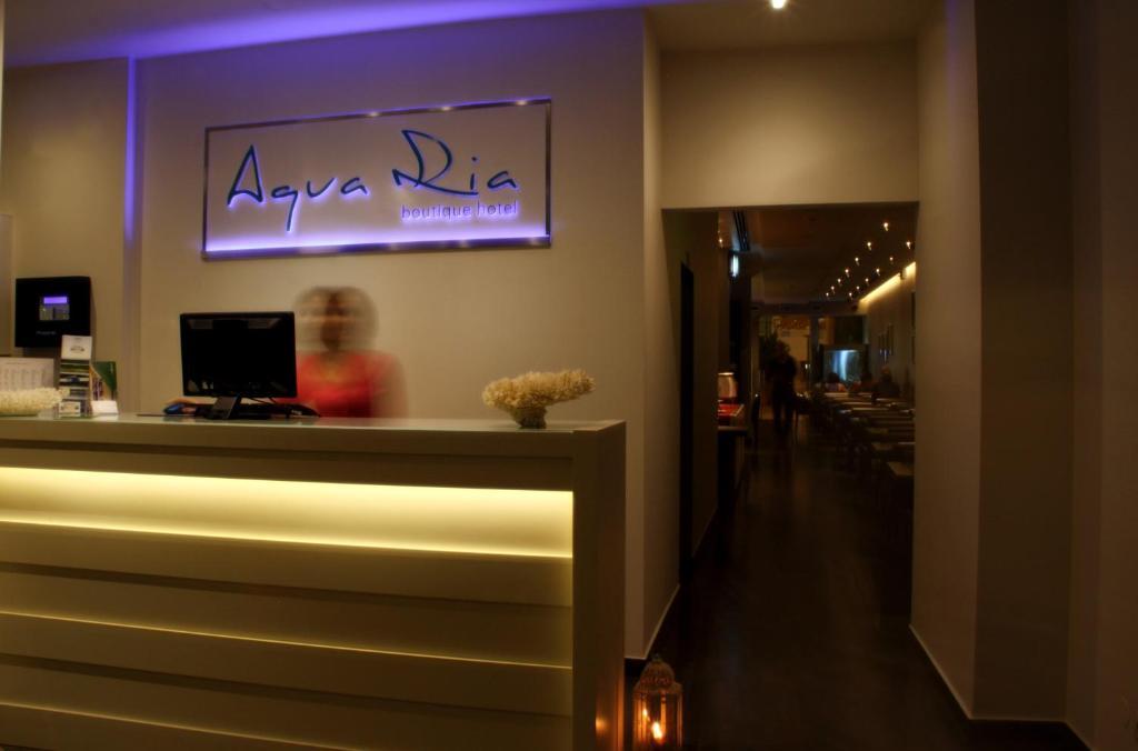 A área de receção ou átrio de Aqua Ria Boutique Hotel