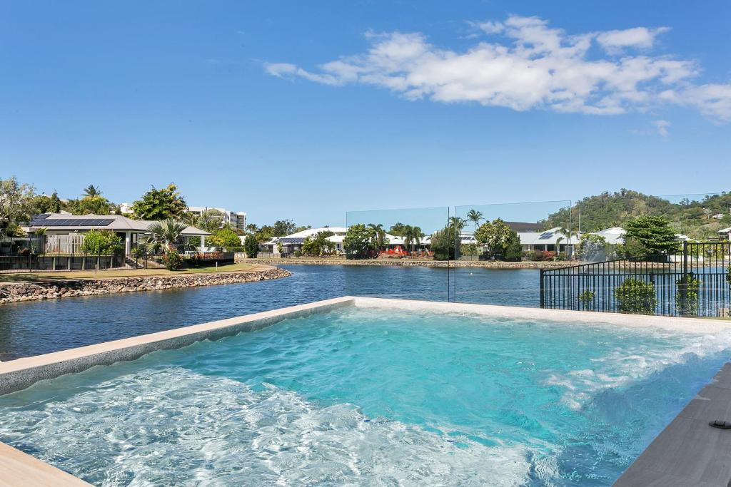 The swimming pool at or near Isle Be Back Trinity Beach Waterfront Brand New Luxury House With Pool