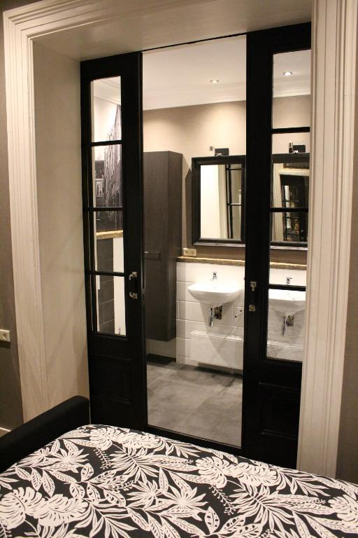 A bathroom at Logement De drie stokvisschen