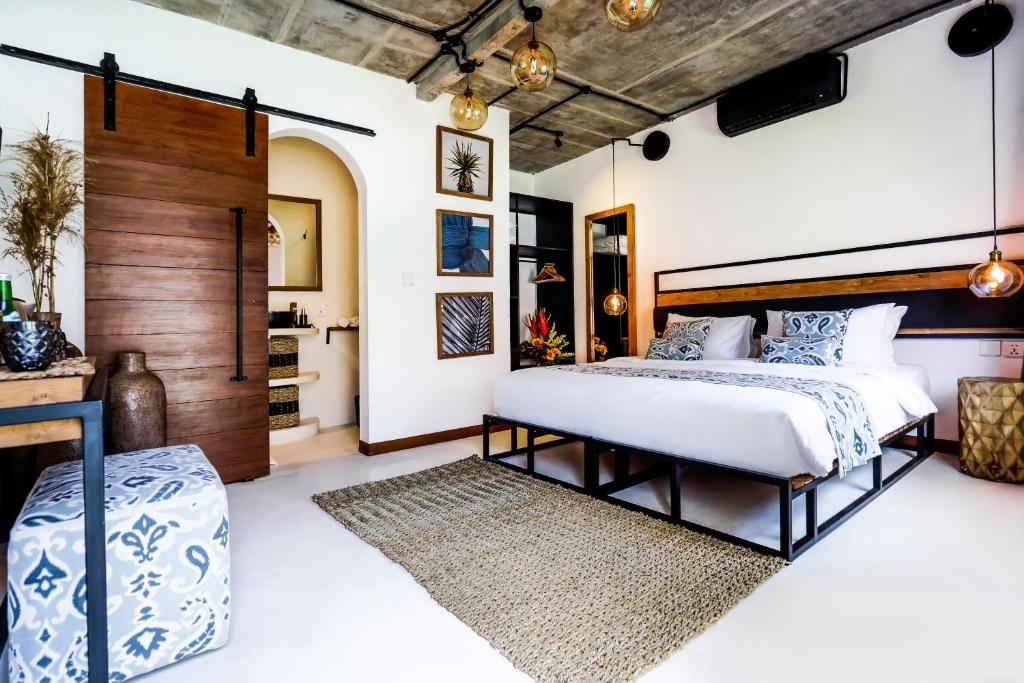 A bed or beds in a room at Body Factory Bali