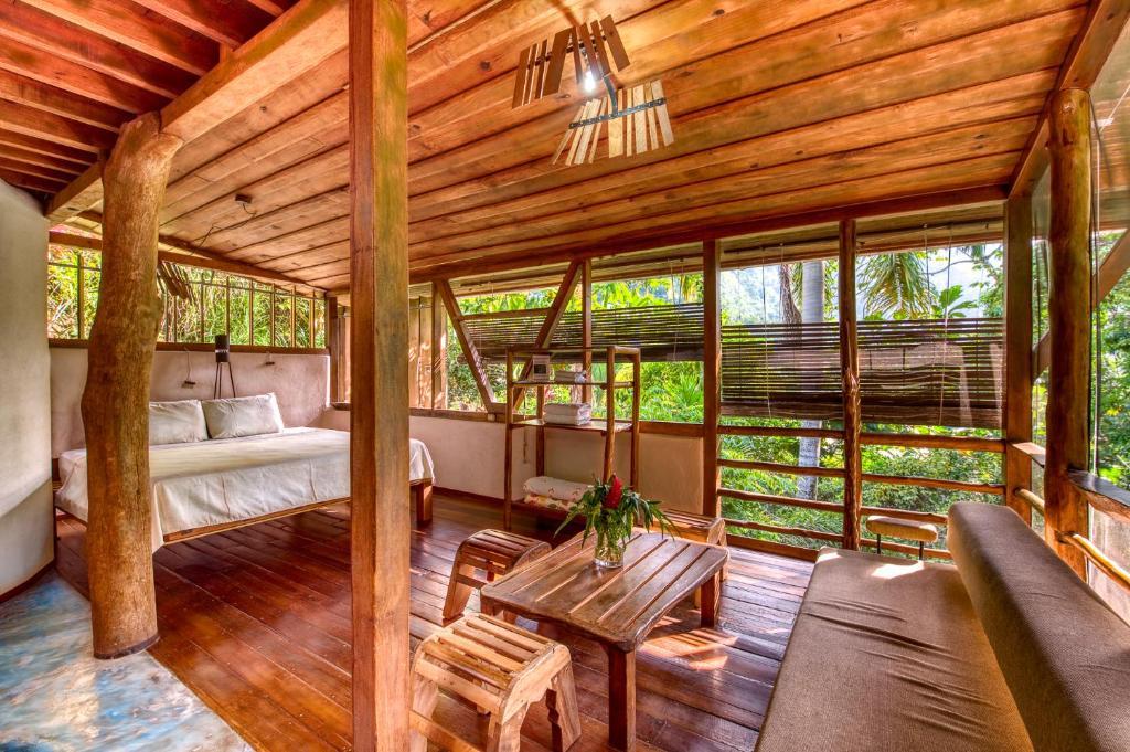 A seating area at Omega Tours Eco-Jungle Lodge