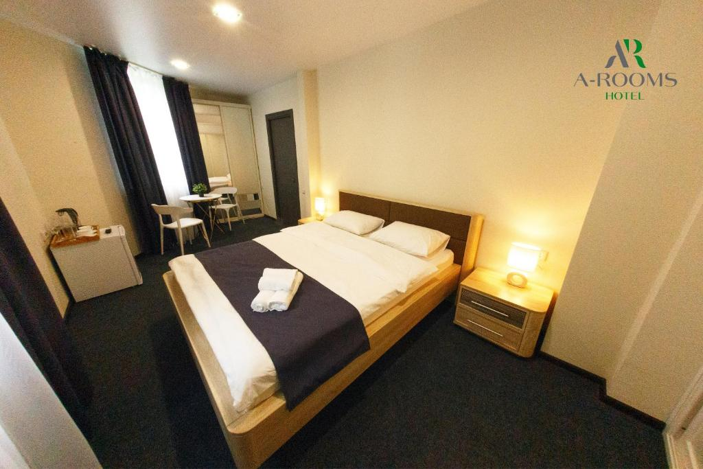 A bed or beds in a room at A-Rooms