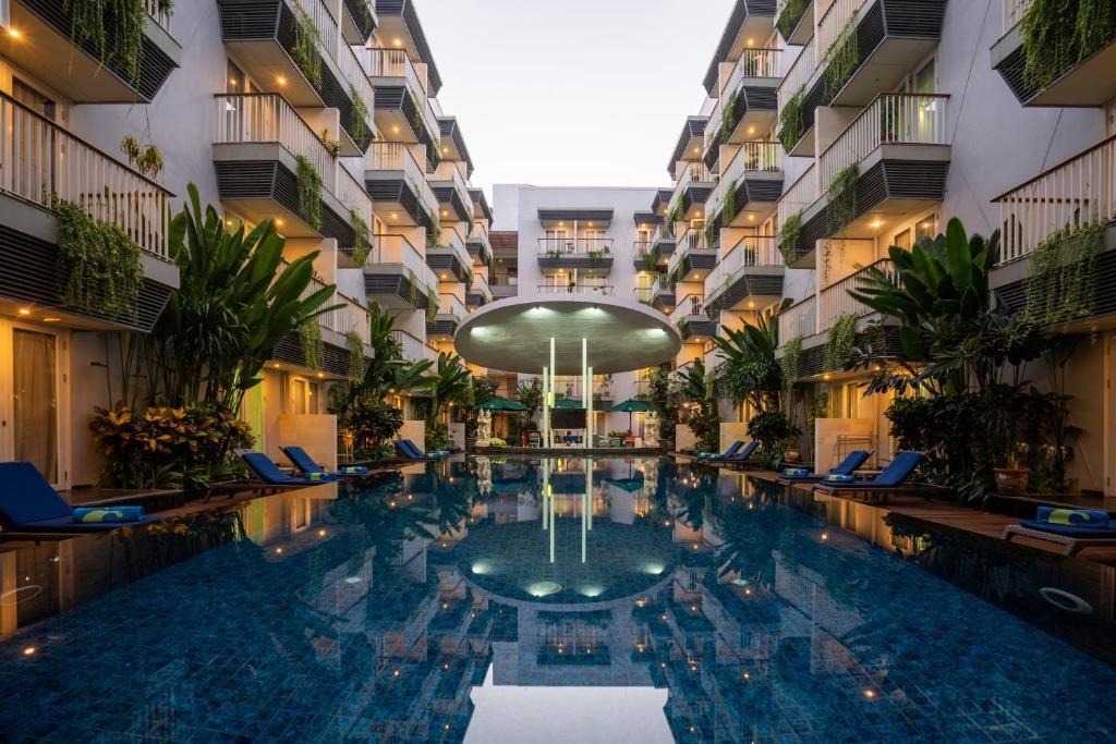 The swimming pool at or near EDEN Hotel Kuta Bali