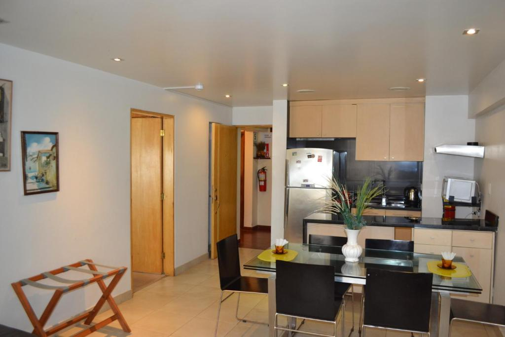 A kitchen or kitchenette at Suite Service Apart Hotel