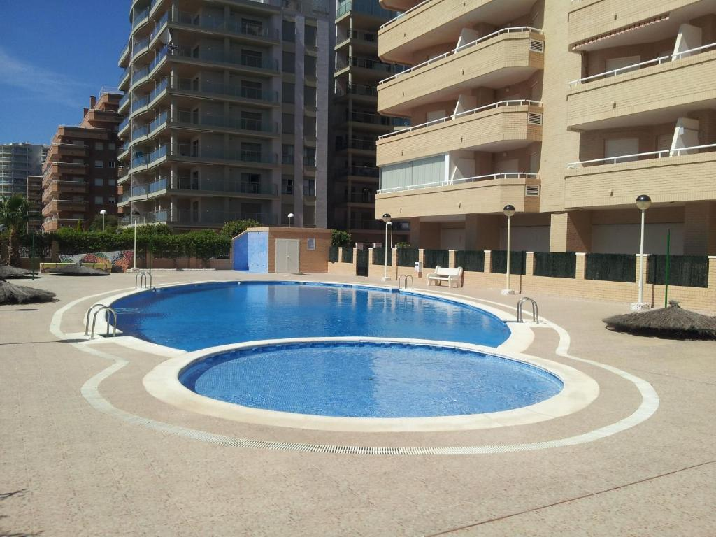 The swimming pool at or close to ACV- Cala Blanca II-1ª Linea Planta 4 Norte 2