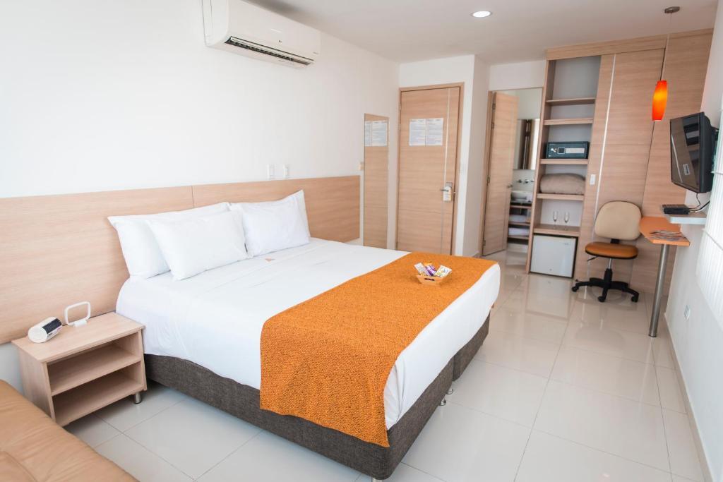 Cama o camas de una habitación en Hotel Cabreromar