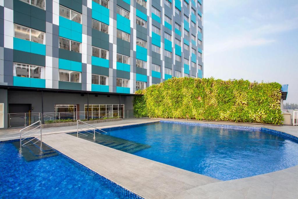 The swimming pool at or close to ibis Styles Bekasi Jatibening