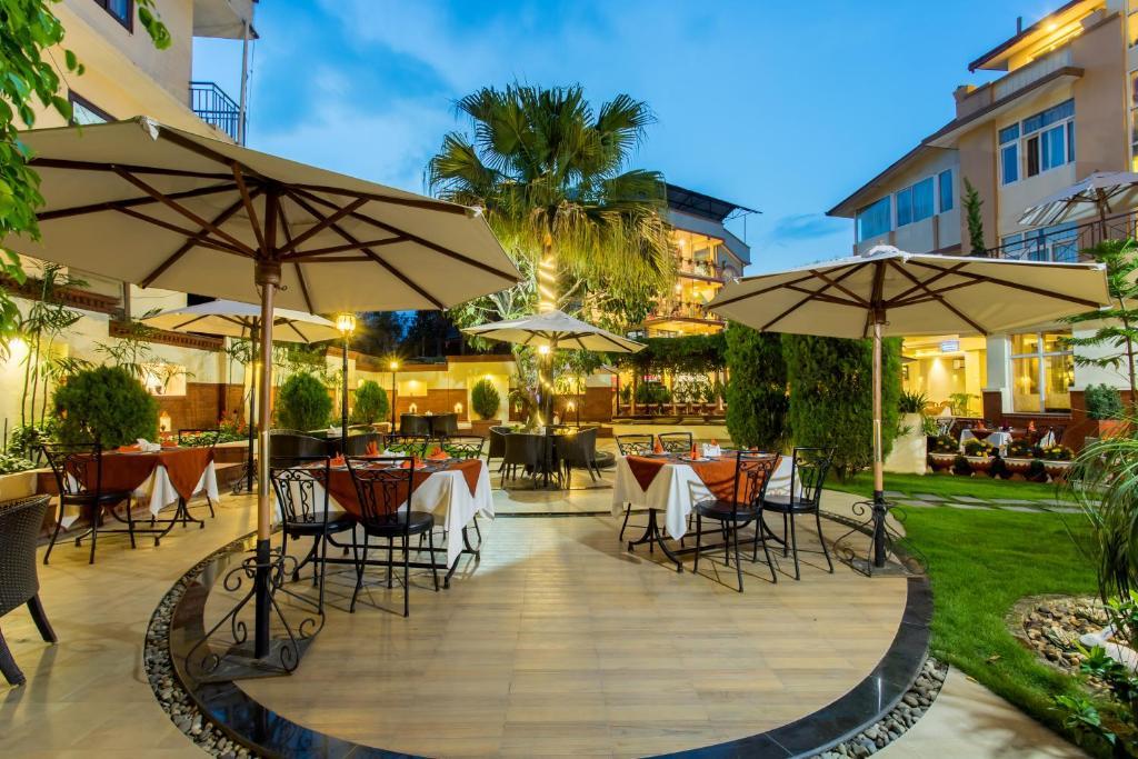Un restaurante o sitio para comer en Hotel Moonlight