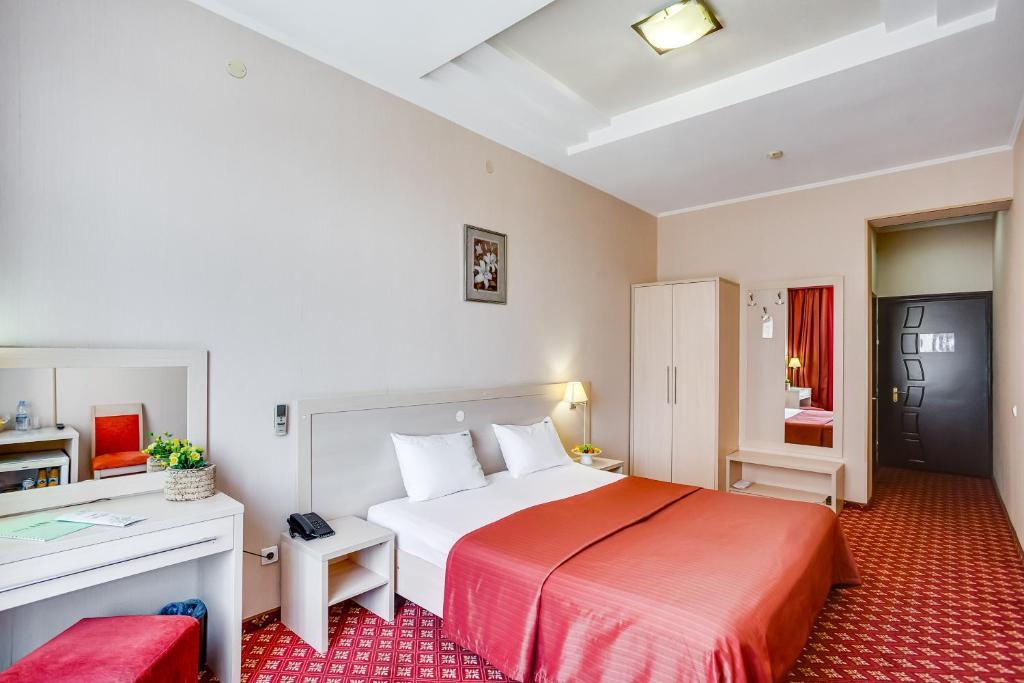 Кровать или кровати в номере Парк Сити Отель